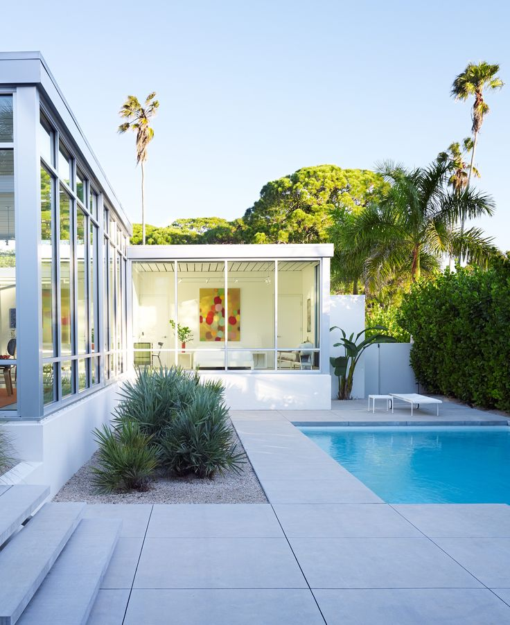 Sarasota, Florida home. This is how you do new construction in a mid century style. Love the concrete pavers, the floating steps, and the landscaping. Is that DG?