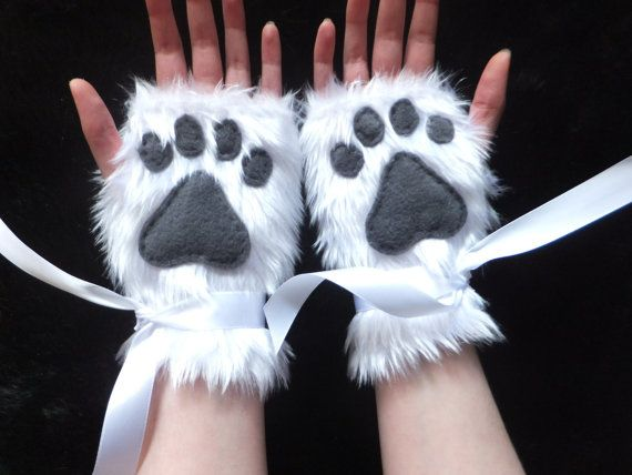 Pair of gloves made from fluffy white faux fur fabric with dark grey fleece paw pads (or choose a different colour from the drop-down menu!).