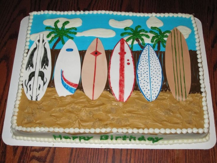 1/2 sheet cake covered in buttercream with fondant surf boards and brown sugar sand.