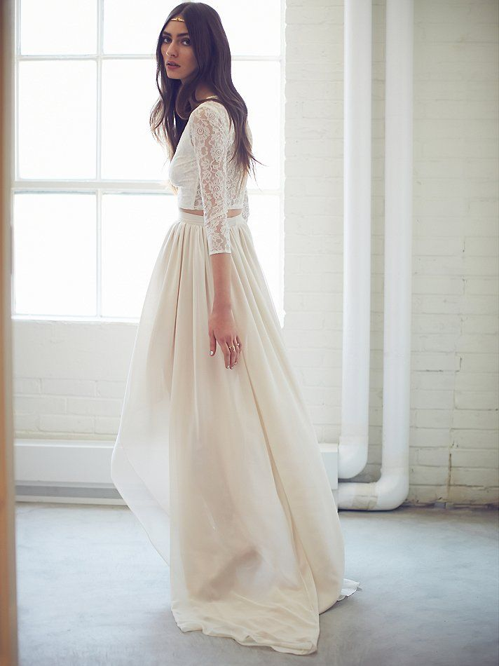 "Callie Set | In this modern, non-traditional two-piece wedding dress, she said ""I do"" to the love of her life.  The delicate floral lace three-quarter length sleeve crop top flattered her in all the right ways as her high-waisted high low hem maxi skirt swayed as she danced.  The top features sheer lace, with lining along the front and a low scoop neck.  Skirt has a hidden back zip."