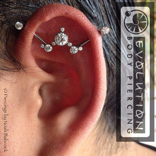 noahbabcock:  Fresh #industrialpiercing with custom designed by me #titanium jewelry by #anatometal (at Evolution Body Piercing)