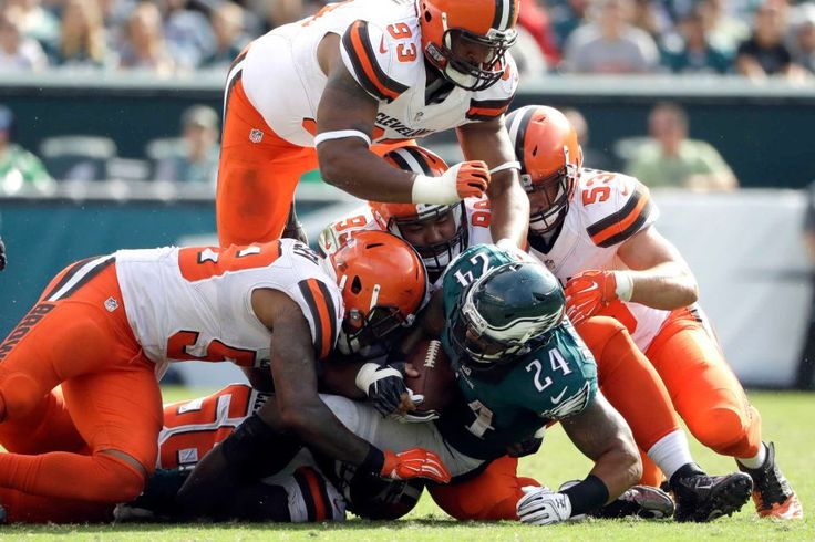 Philadelphia Eagles' Ryan Mathews is tackled by the Cleveland Browns defense during the second half of an NFL football game Sunday, Sept. 11, 2016, in Philadelphia.