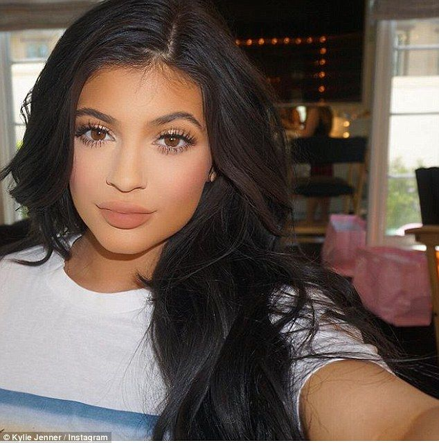 The show must go on: Despite her sister Kourtney's heartbreak, Kylie Jenner was hard at work promoting her new venture with a sultry selfie on Monday