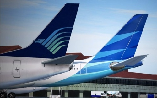 "Garuda Indonesia changed from it's old ""Mythical Bird"" livery to the new ""Nature's Wing"" livery as part of a corporate rebranding in 2009."