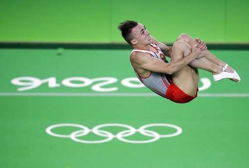Hancharou of Belarus ends China's run in Olympic trampoline: August 13, 2016 - Belarus' Uladzislau Hancharou performs during the men's trampoline final at the 2016 Summer Olympics in Rio de Janeiro, Brazil, Saturday, Aug. 13, 2016. (AP Photo/Julio Cortez)