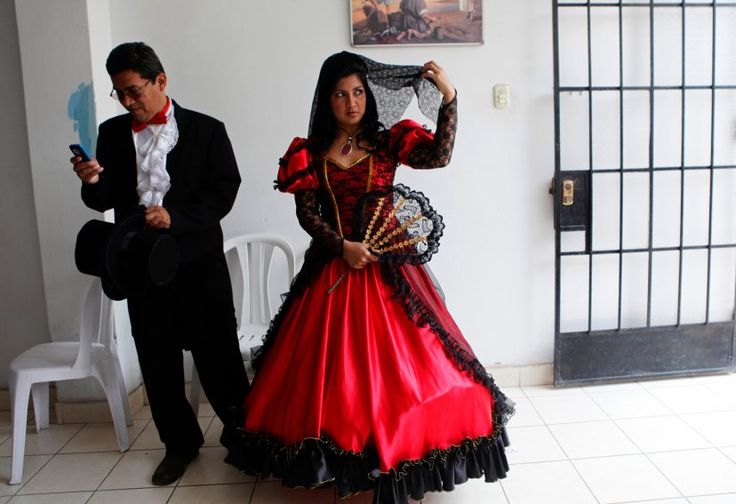 In the highlands above Lima, Peru, traditional brides make quite a splash in red and black gowns, made bigger by multiple layers of heavily embroidered cotton petticoats.