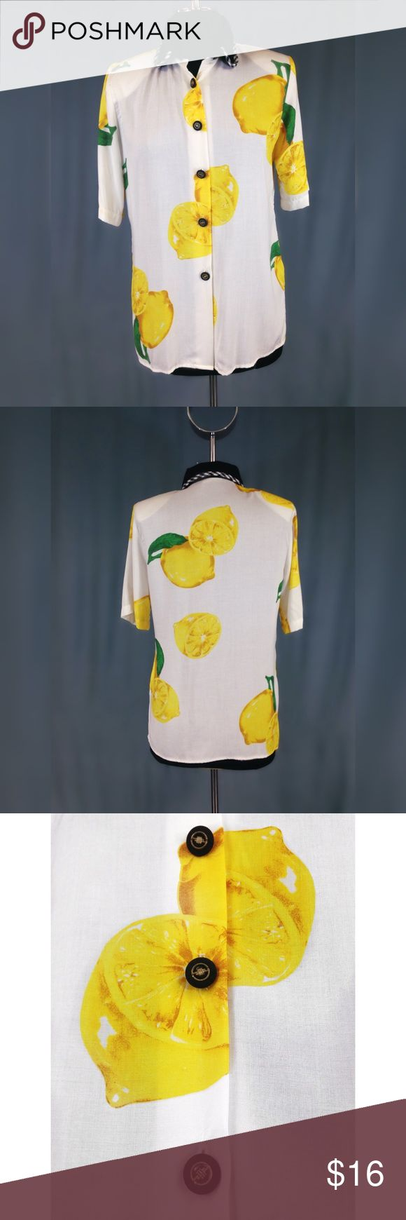 """White Lemon Print Blouse What's more summery than a crisp white blouse with freakin bright yellow lemons on it?!   I'm overly excited about this shirt.  Half-length sleeves and a black collar with gingham trim, black and gold buttons, and LEMONS.  I love """"tacky old lady blouses"""" tucked into tight leather Moto pants, a wide brimmed fedora and a delicate strappy stiletto.    Brand: Kathie Lee Size: M  MEASUREMENTS Length: 26"""" shoulder to hem Bust: 38"""" pit to pit Waist: 36"""" Hem: 40"""" Tops…"""