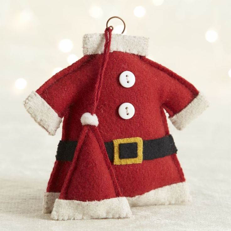 The suit without the Santa is a fun twist on the St.  Nick ornament for the tree or the cleverest gift tag.  Hand-sewn suit with cuffs, collar, belt and button detailing is paired with the traditional pom-pom hat. Handcrafted100% feltMade in India.