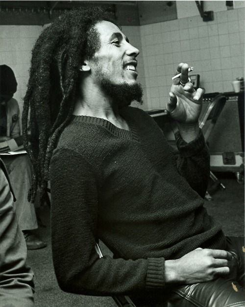 Bob Marley (not sure he is smoking a traditional cigarette...but smoking nonetheless) :-)
