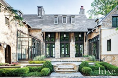 Neutral Stone Entrance Architect: Culligan Abraham Architecture Home Builder: Thomas J. Cowan Landscape Architect: Sheldon Landscape Shape of house
