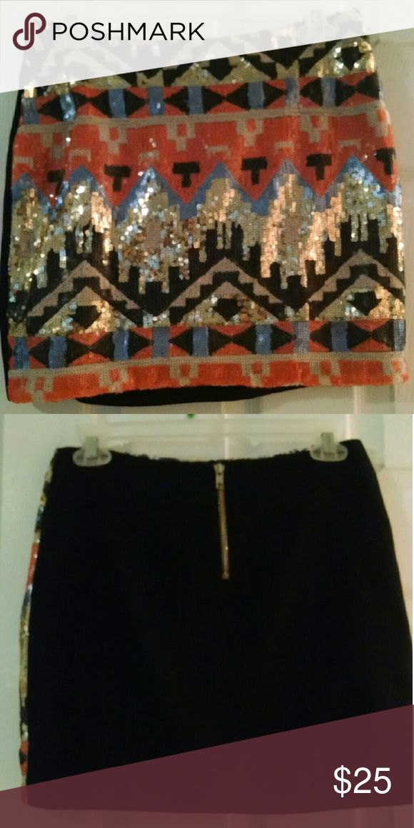 Aztec Sequin Mini Add a little sparkle to your life! Fun, colorful skirt that makes any occasion a special occasion. Solid black back with zipper. In great condition being worn twice! Skirts Mini