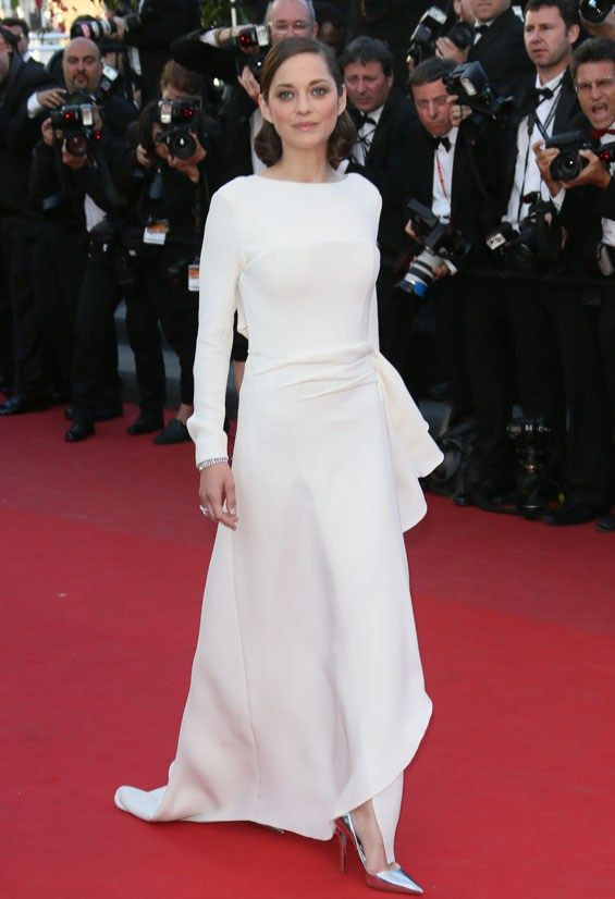 Sleek and elegant in all-white gown Marion Cotillard walks the red carpet at this year's Cannes film festival.