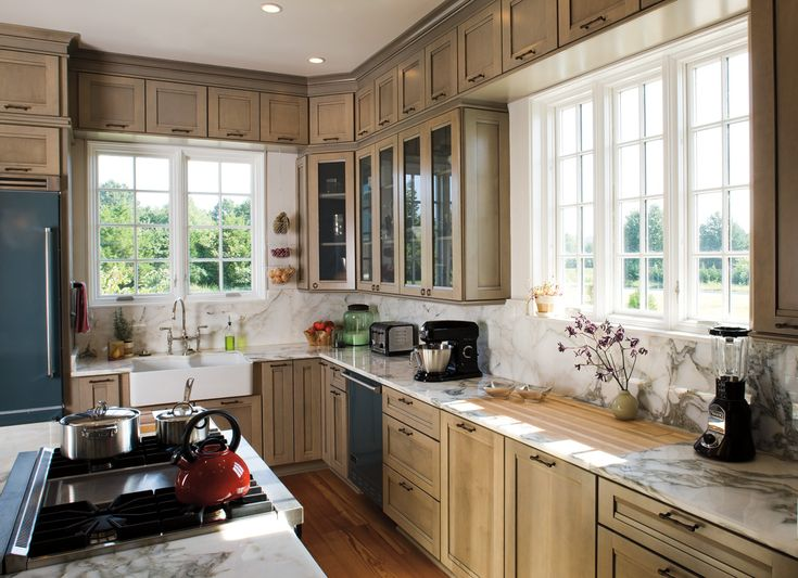 surprising kitchen lots windows   This charming Southern-style farmhouse kitchen gets lots ...