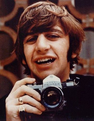 Ringo with a Pentax SLR. Image credit: Celebrity Camera Club