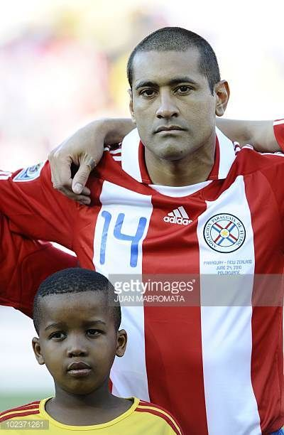 Paraguay's defender Paulo da Silva listens to his national anthem prior to the start of the Group F first round 2010 World Cup football match...