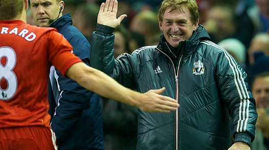 High five: Kenny Dalglish celebrates with Steven Gerrard