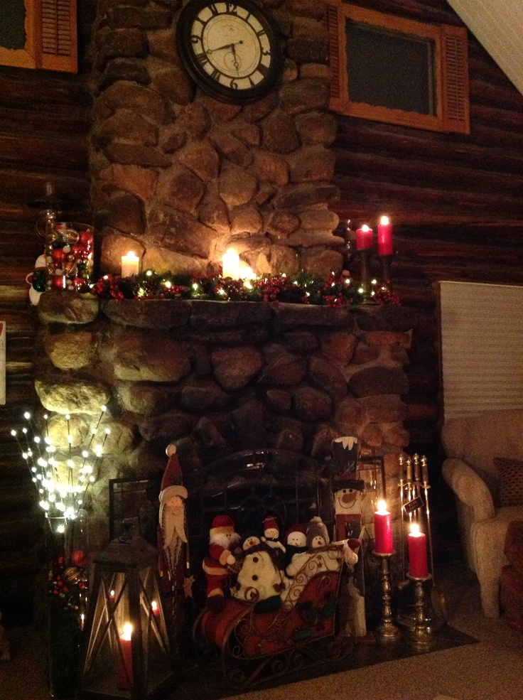 christmas decorated fireplace mantle log cabin christmas