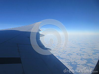 Photo from airplane, flying in the sky.