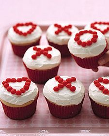 Use cinnamon candies to create the Xs, Os, and hearts on these clever Valentine's Day cupcakes.