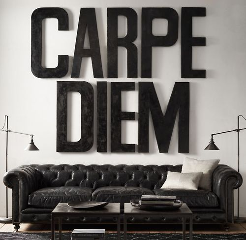 """seize the day... oversized letters spelling """"carpe diem"""" in place of artwork above large vintage leather chesterfield sofa"""