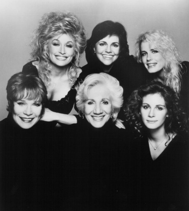 "Sally Field as M'Lynn Eatenton,  Dolly Parton as Truvy Jones,  Shirley MacLaine: Louisa ""Ouiser"" Boudreaux,  Daryl Hannah as Annelle Dupuy Desoto,  Olympia Dukakis as Clairee Belcher, &  Julia Roberts as Shelby Eatenton Latcherie in Steel Magnolias 1989"