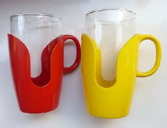 Vintage Pyrex Mugs with Plastic Holders - we had some of these in blue