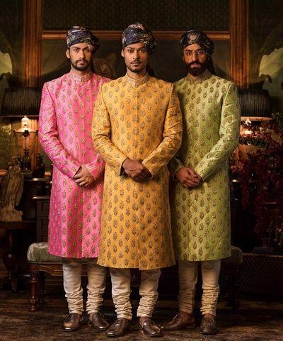 Groom Wear - Sabyasachi Pastel Shade Sherwanis   WedMeGood   Pink, Yellow and Green Sherwani with Gold Embroidery and Floral Head Gears #wedmegood #indiangroom #groomwear #sherwani #indianwedding #sabyasachi #sabyasachigroom #