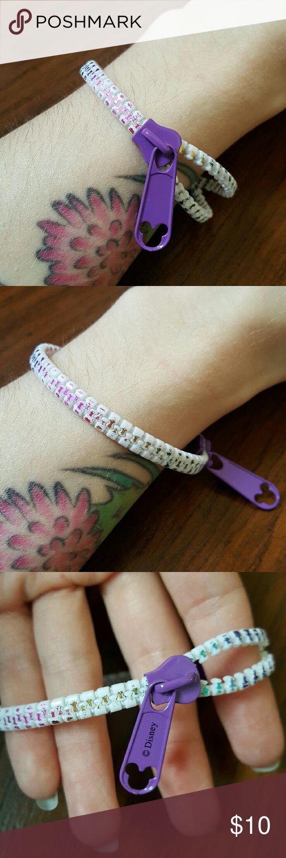Disney Purple Zipper Bracelet Disney Purple Zipper Bracelet, plastic zipper with rainbow foil accents, snap closure. Disney Jewelry Bracelets