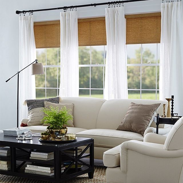 It's a sheer thing! Make your living room a sweet escape with lovely linen sheers and neutral textured shades. (Country Curtains Sheer Linen Rod Pocket Curtains and Textured Woven Shades)