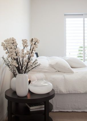 Loutit's pared back aesthetic flows through to the master bedroom.