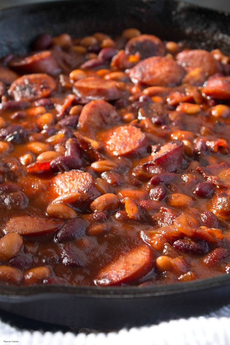 Chipotle Bourbon Porky Beans ~ This delicious skillet meal gives classic pork and beans a boozy twist. Bacon, kielbasa & 2 kinds of beans in a rich chipotle bourbon BBQ sauce.