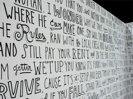 hand-drawn type mural tradeshow booth // Timothy Goodman