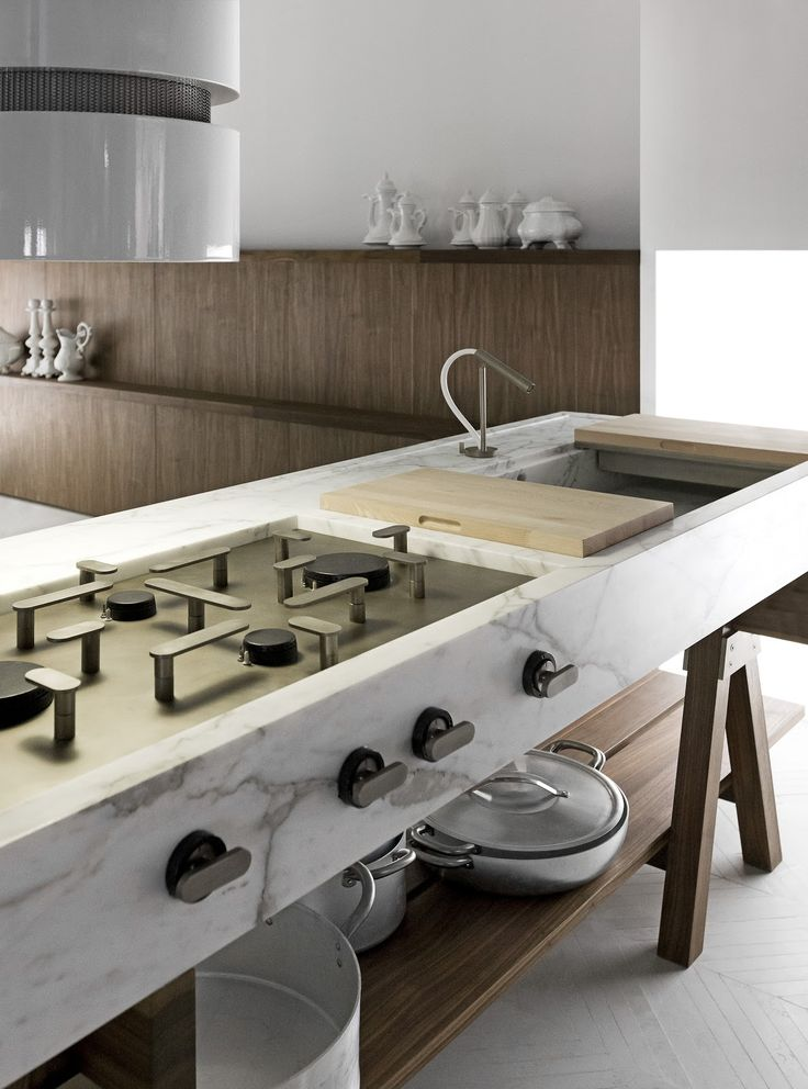 Enzo Berti created the handsome Dolmen kitchen with cooktops and sinks integrated into 'tables' that can be strategically placed within a space. Take your pick from an elegant materials palette that features walnut or larch wood and three types of marble. madeinlando.it