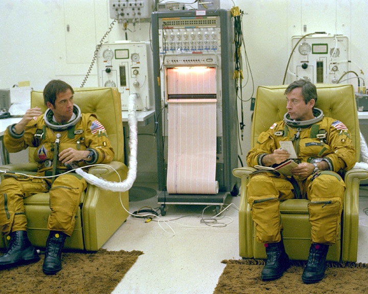 Astronauts John Young and Bob Crippen suit up before the