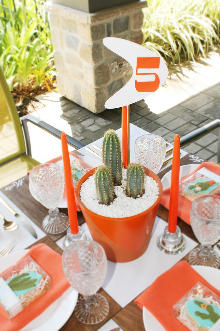 Orange themed table with modern cactus centerpieces and