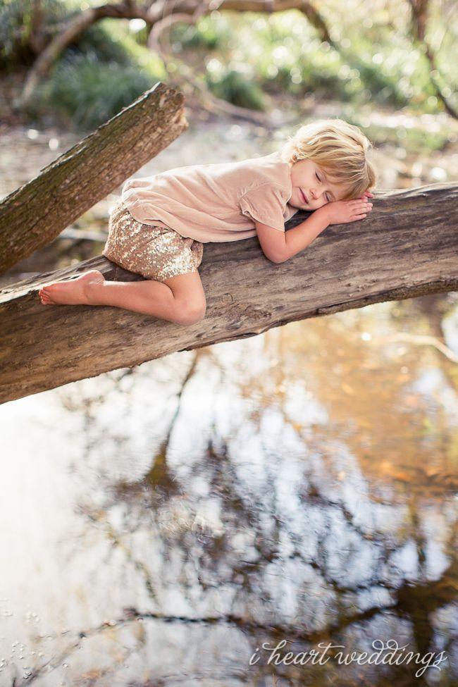Little girl sleeping on a branch. awww