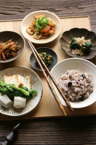 Japanese dishes (via bananagranola) multi grain rice, simmered satoimo and atsuage and nanohana, kinpira gobo, sauted lotus root and pumpkin salad, spinach ohitashi, stir-fried turnip leaves with sesame oil
