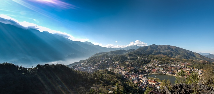 Sun rays pierce the clouds from the top of San May (The Cloudyard) in the village of Sa Pa