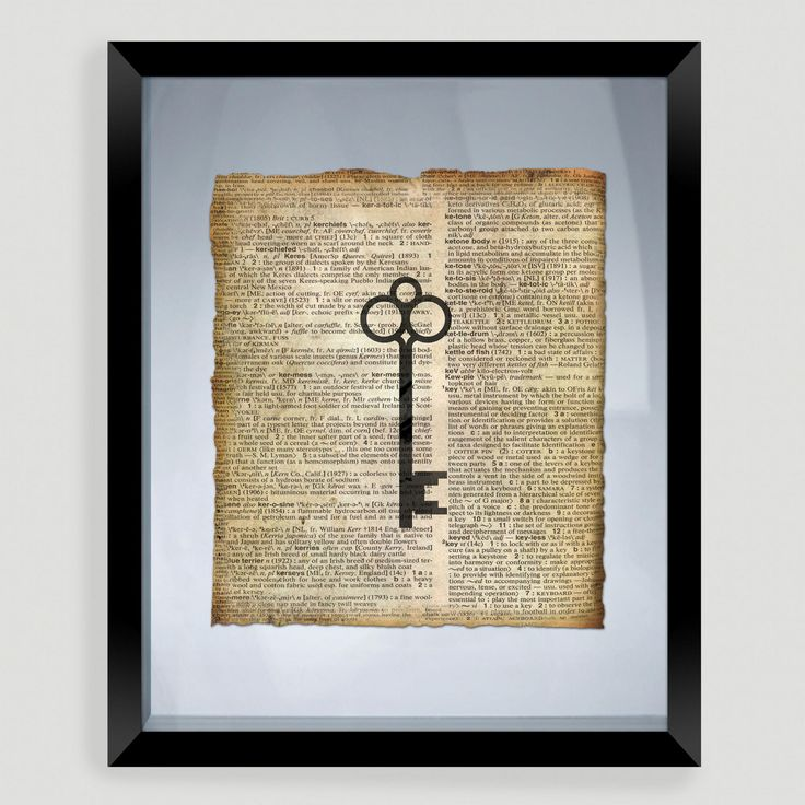 Key Print Wall Art | World Market. DIY Thrift shop a book you love and tea stain it. Then get an old vintage key and frame from Michaels craft store. Cheap and easy.