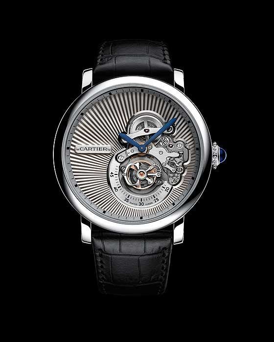 The @cartier Rotonde Cartier Reversed Tourbillon has an unconventional flying tourbillon, displayed on a minimalist, sunburst-guilloché dial with an off-center hours and minutes display. #cartier #watchtime #luxurywatch