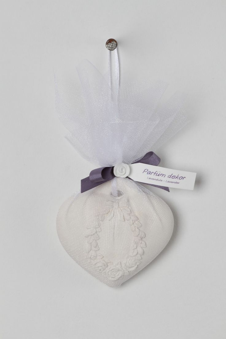 Hand Crafted Lavender Clay Hearts resting in Gorgeously hand knitted purse. Authentic French lavender scent spiked with organic lavender essential oils,