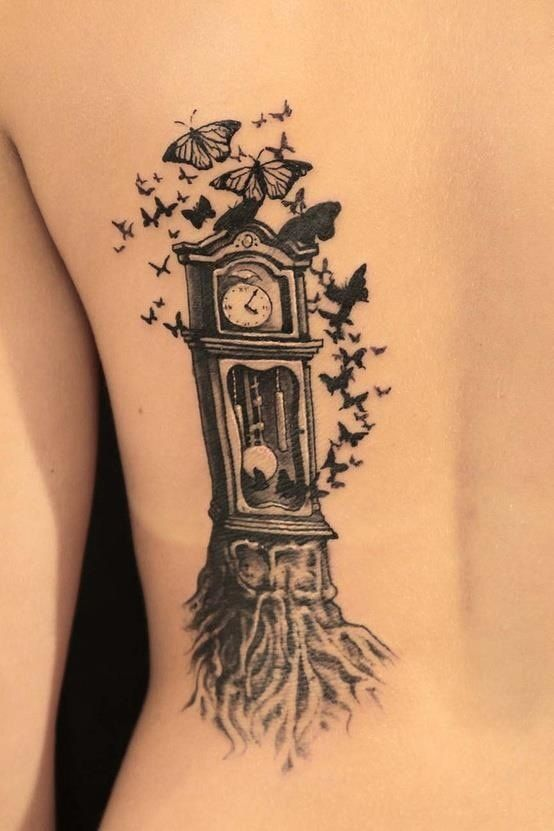 grandfather clock tattoos | Black & gray grandfather clock with roots and butterflies back tattoo ...