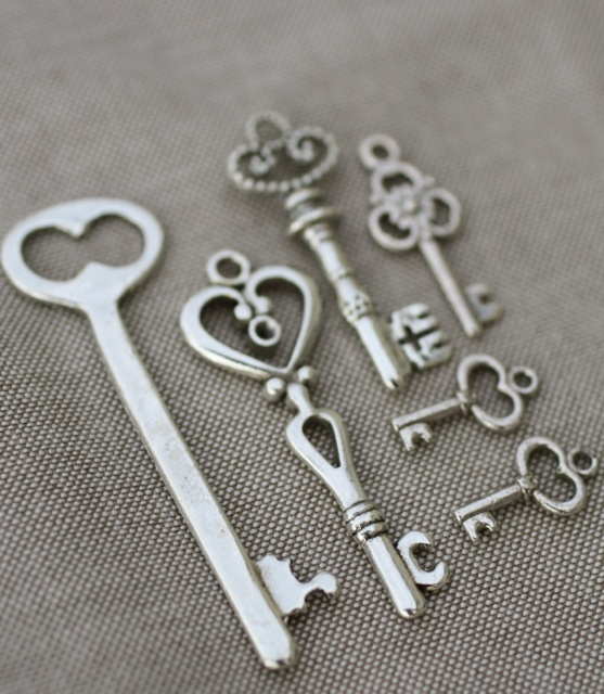 """Each set includes 6 key charms for only $1.97!   They won't open your car door, but they will make a modern necklace or a stylish pair of earrings.  Dangle one from a long chain or add them all to a hoop for a fun """"key ring"""" look.  Keep them shiny silver or age them with paint for a vintage look!  We've included a wide range of sizes so you'll have a key for every occassion and more.  So many keys, so many possibilities!"""