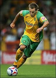 Hucks in his original kit as a Norwich City Canary