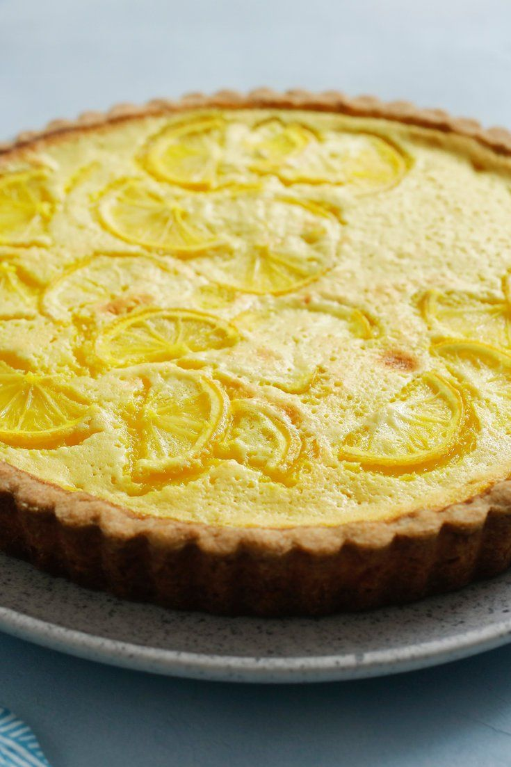 """NYT Cooking: Somewhere between a lemon bar and a lemon pie lies this ultra tangy tart. """"Tart"""" makes it sound difficult, but it's easier than you think: The rich filling requires zero cooking, and the crust is a simple shortbread that you just press into place. The already vibrant yellow filling gets an assist from a bit of ground turmeric. It's an ingredient that you won't taste as much as you'll see, but i..."""