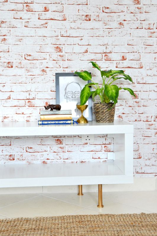 We're obsessed with this amazing makeover from The Desi Wonder Woman, who took an ugly black console and made it light and airy, with offset gold legs. It's an amazing makeover that proves how much difference a coat of white paint makes.