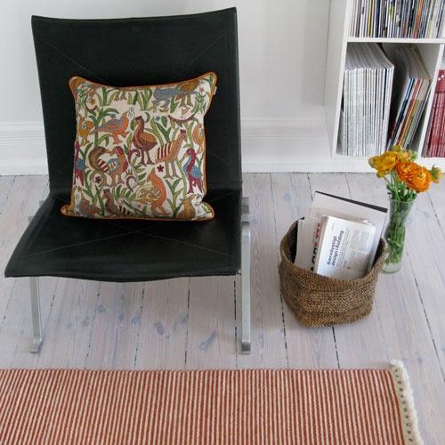 Tikau Stripe hand made wool carpet, hand embroided cushion cover Birds, banana fiber basket Foldi M design Taina Snellman