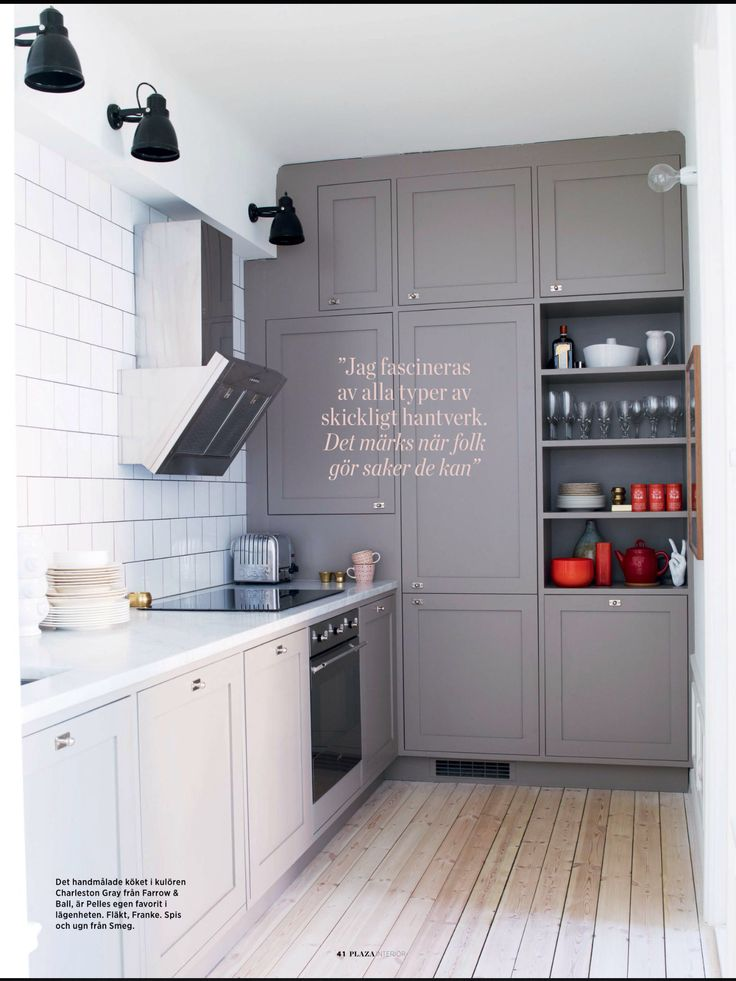 Contrast  Grey and white kitchen like the floor to ceiling storage wall and no other wall units.