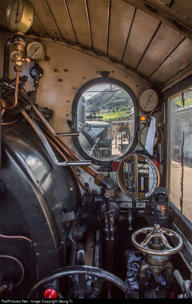 """Controls and instruments on the footplate of the steam locomotive B 3/4 # 1367 of SBB Historic in Airolo. Electrolocomotive Ae 6/6 # 11411 """"Zug"""" is coupled in front, to pull the steamer through the 15 kilometer long Gotthard tunnel to Göschenen."""