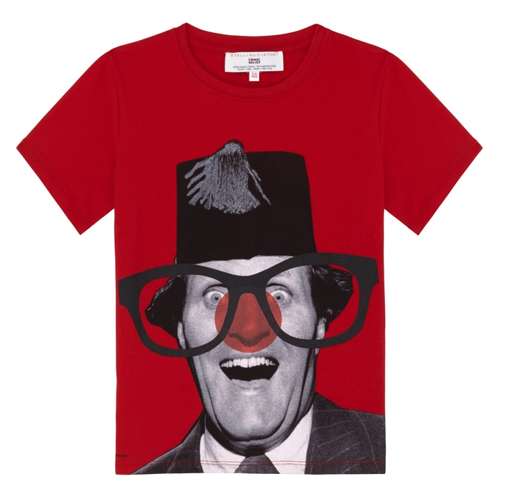 Tommy Cooper Kids Red Nose Day T-shirt. A red T-shirt featuring a striking black and white photograph of legendary British comedian Tommy Cooper, with the addition of a red nose and glasses. Designed by Stella McCartney exclusively for Red Nose Day. With at least £2.50 going to Comic Relief, helping to change lives across the UK and Africa, this t-shirt is £5.99. 100% organic Fairtrade certified cotton. Wash at 40.